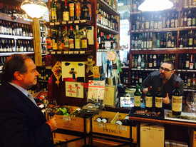 Visiting a liquor store in New York with Michel Rolland